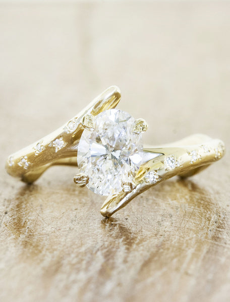 unique asymmetrical band oval diamond ring, yellow gold
