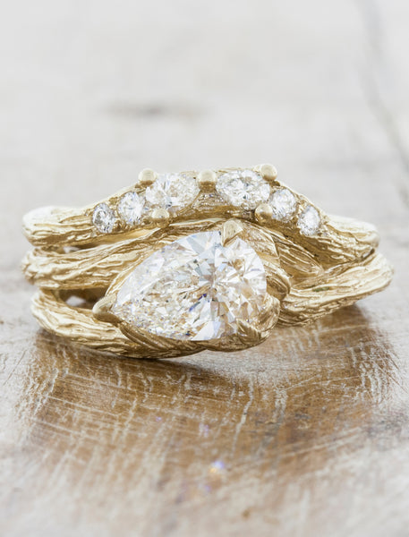 Nature inspired engagement ring bark texture split shank;caption:1.20ct. Pear Diamond 14k Yellow Gold paired with Isle wedding band
