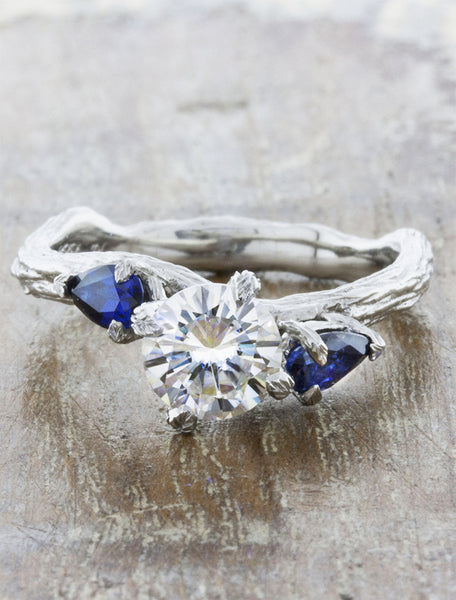 Nature inspired three stone setting;caption:0.95ct. Round Diamond and Sapphire, customized with bark texture, 14k White Gold