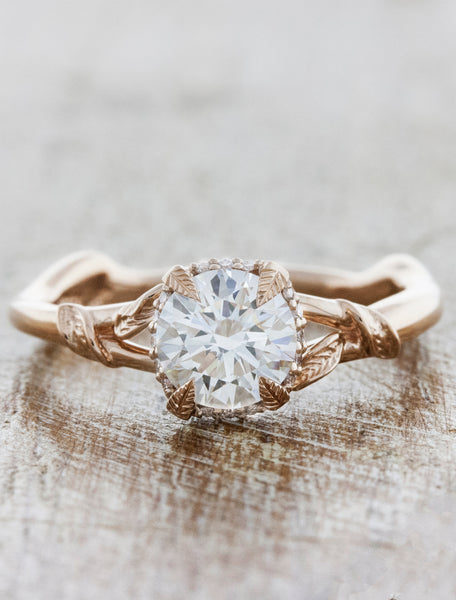 leaf band 4-prong diamond solitaire engagement ring. caption:Shown with 0.70ct diamond option
