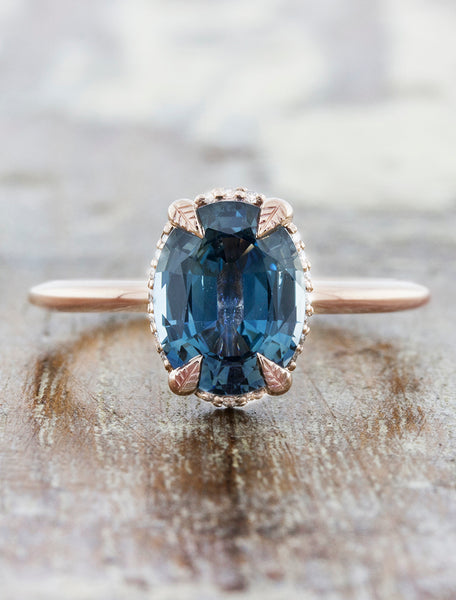 caption:Shown with blue sapphire set against rose gold