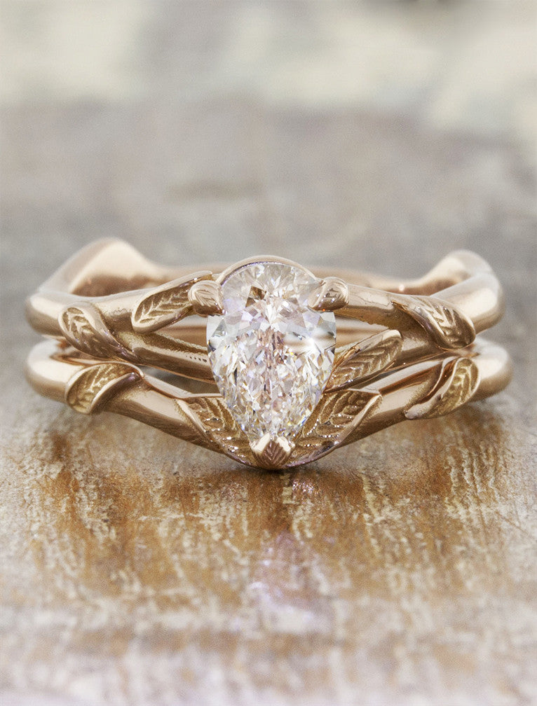 overlapping leaf design wedding ring - paired with pear shaped engagement ring