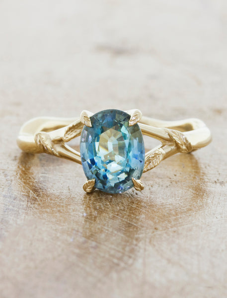 Nature inspired engagement ring;caption:1.60ct. Oval Sapphire 14k Yellow Gold