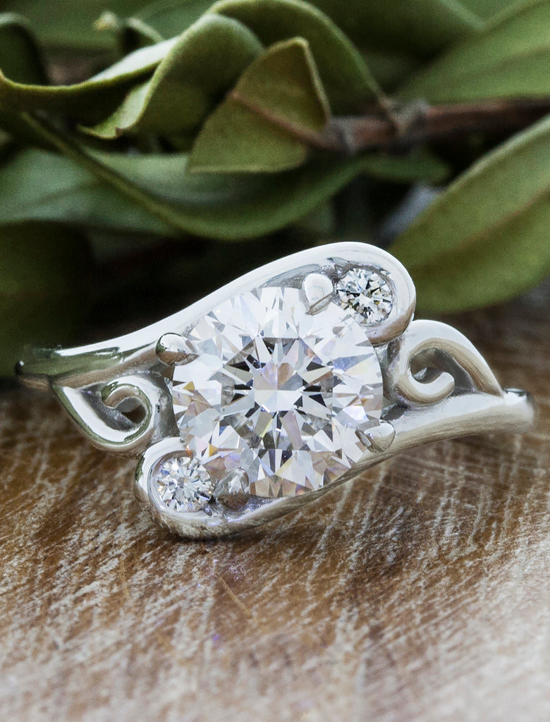 ornate swirling diamond engagement ring