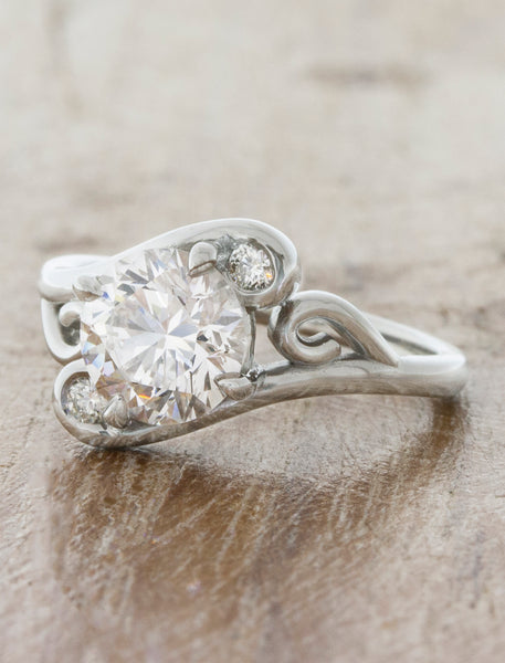 swirling diamond engagement ring with split band