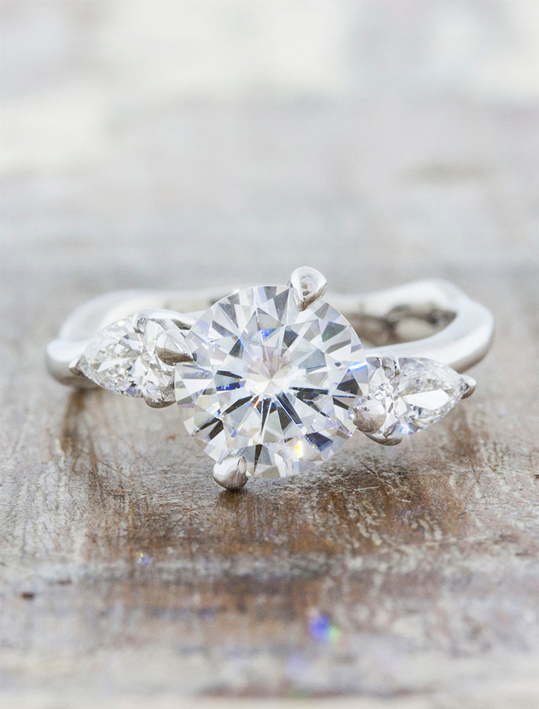 Bueti caption:1.25ct. Round Moissanite 14k White Gold