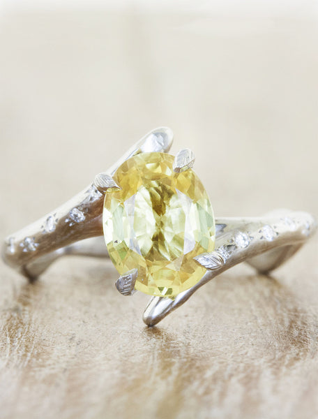unique asymmetrical band oval yellow gemstone ring;caption:1.65ct. Oval Sapphire Platinum