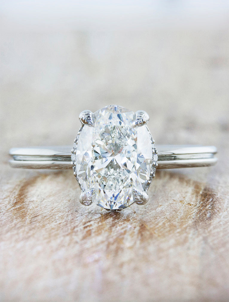 Nature inspired solitaire double band;caption:1.75ct. Oval Diamond Platinum