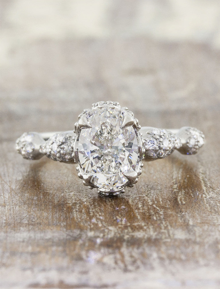 intricate oval diamond engagement ring, platinum band