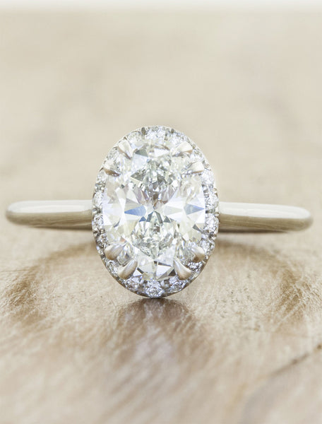 oval diamond subtle halo engagement ring