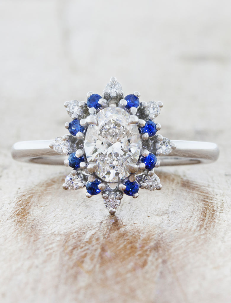 oval engagement ring with vintage inspired star halo