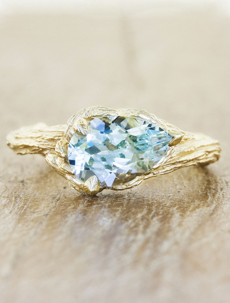 pear shaped aquamarine engagement ring, tree bark band;caption:1.30ct. Pear Aquamarine 14k Yellow Gold