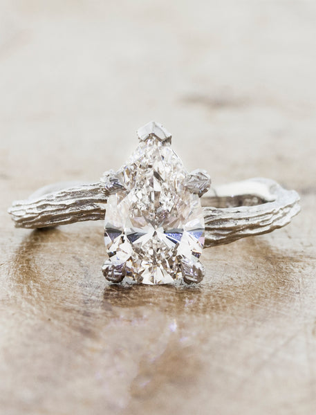 Nature inspired solitaire engagement ring caption:1.50ct. Pear Diamond 14k White Gold