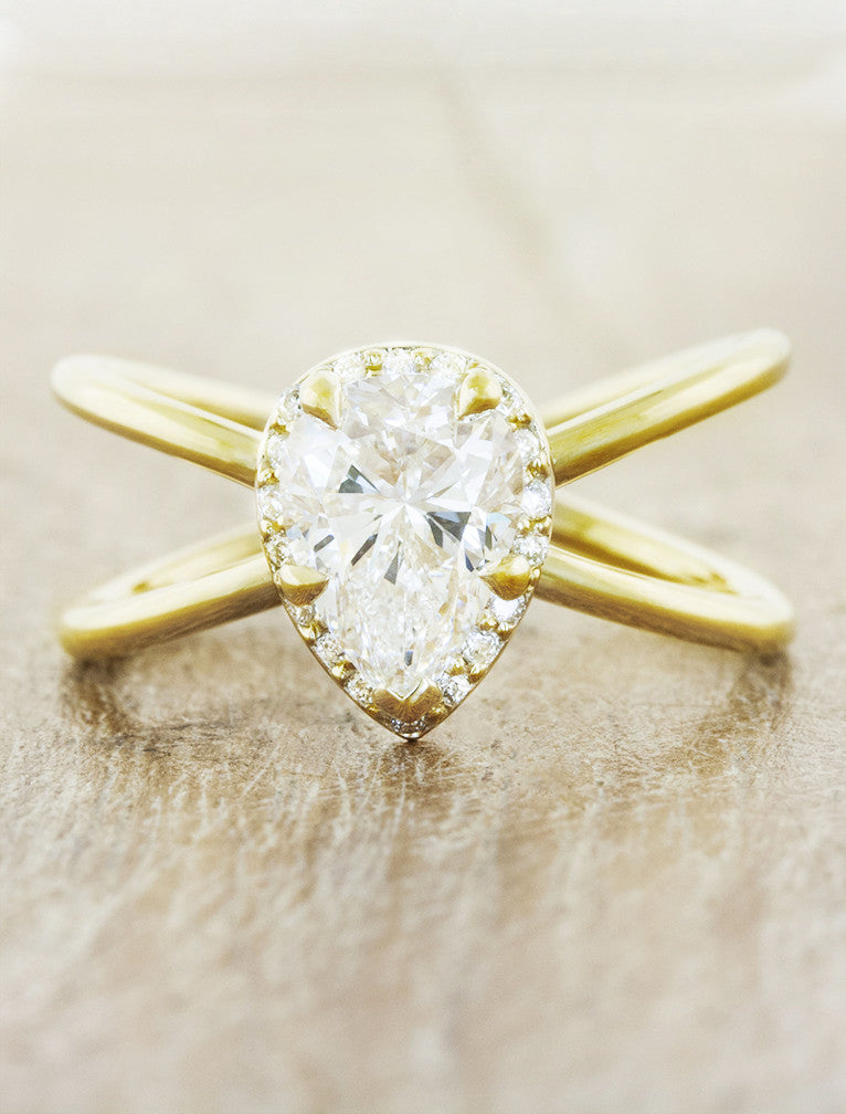 modern pear diamond and yellow gold engagement ring