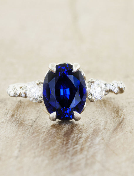 delicate twisted band, oval sapphire engagement ring with round diamond accents