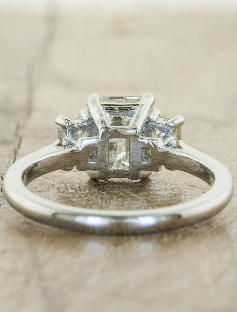 classic three stone emerald cut diamond engagement ring