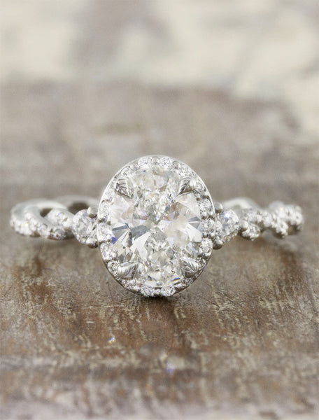 oval vintage inspired diamond ring, twisted band;caption:1.20ct. Oval Diamond Platinum