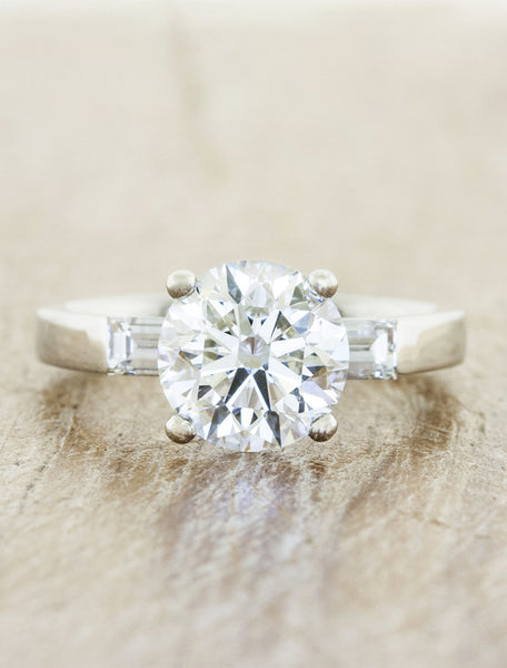 3-stone baguette diamond engagement ring;caption:1.75ct. Round Diamond Platinum.  Customized with straight baguette side stones.