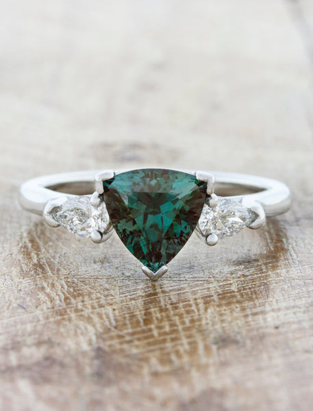 caption:Customized with a trillion shape green sapphire
