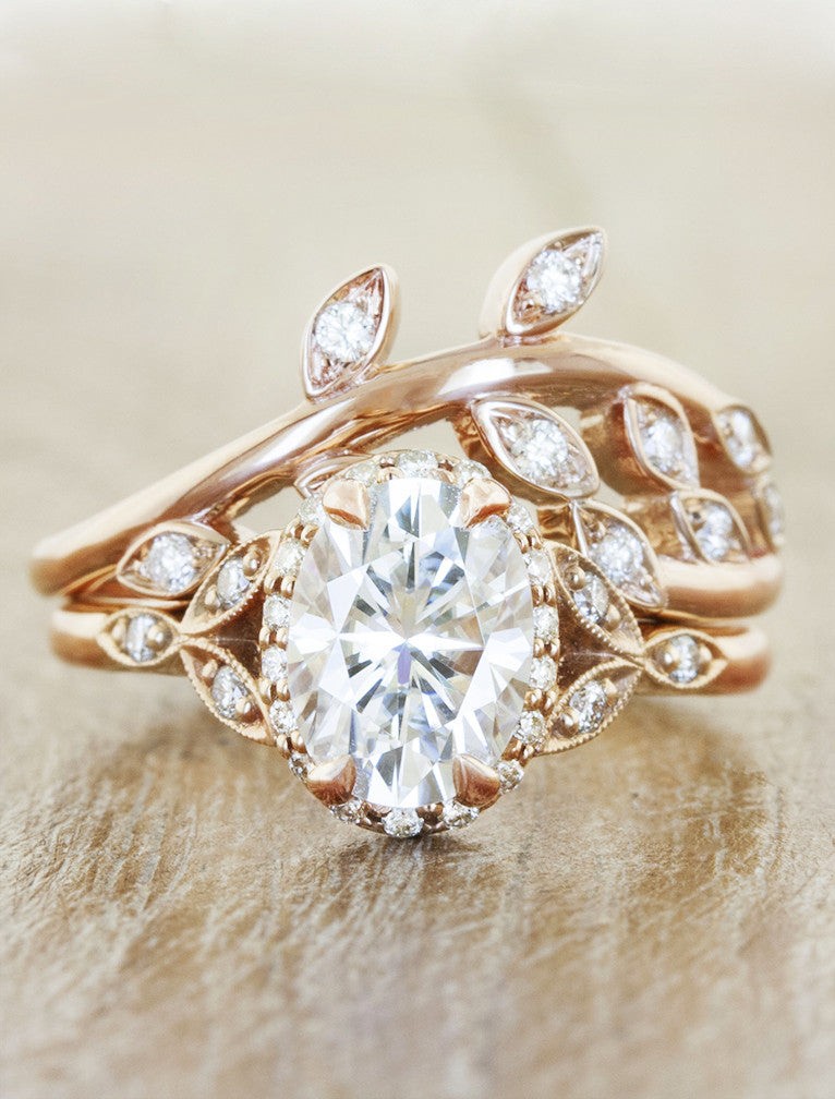 leaf diamonds surrounding romantic rose gold and oval diamond engagement ring