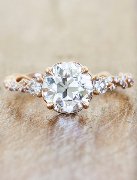 delicate twisted band, round diamond engagement ring with round diamond accents
