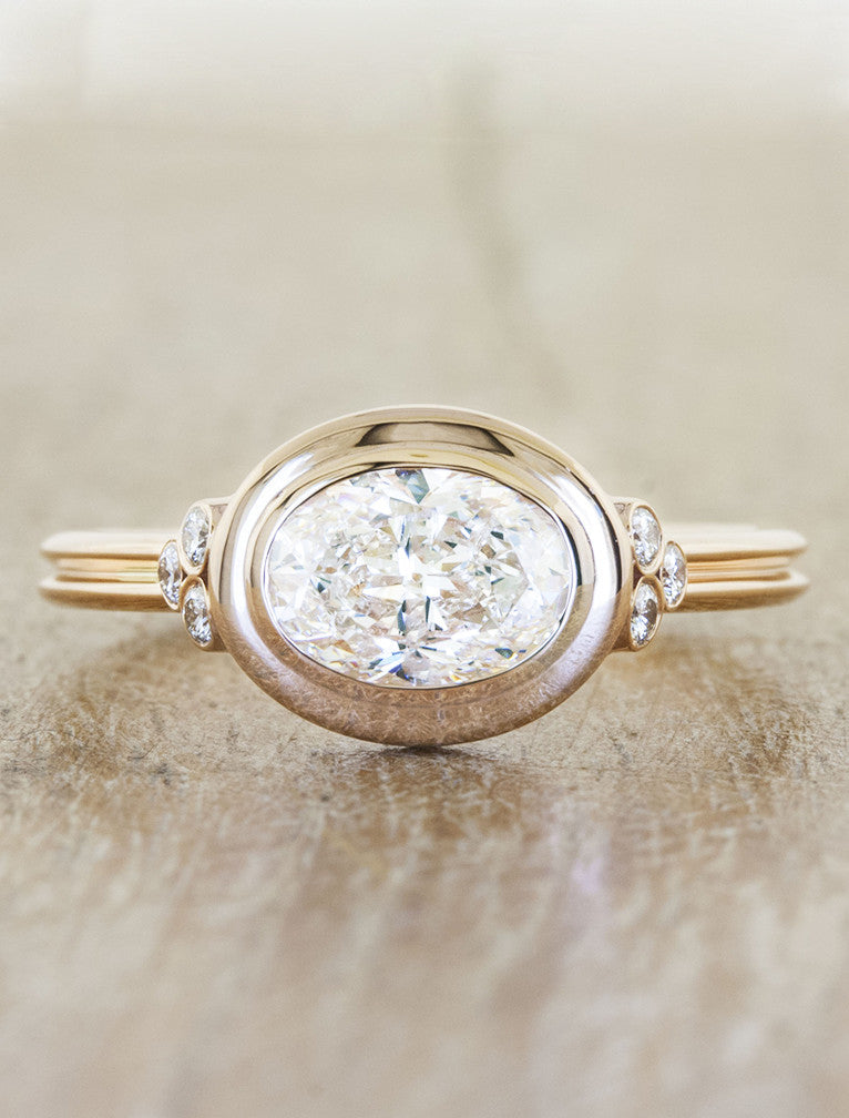 unique oval diamond ring in yellow gold