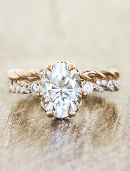 delicate twisted band, oval diamond engagement ring with round diamond accents