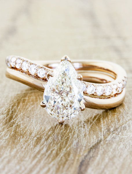 pear shaped diamond ring wave band yellow gold;caption:1.30ct. Pear Diamond 14k Rose Gold paired with Bella wedding band