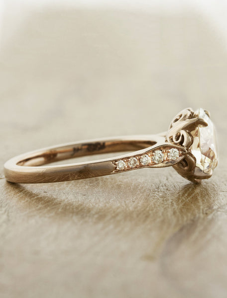 european cut round diamond, rose gold intricate setting engagement ring