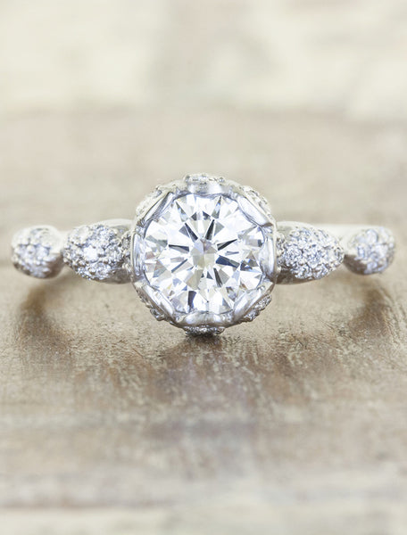 intricate round diamond engagement ring, platinum band