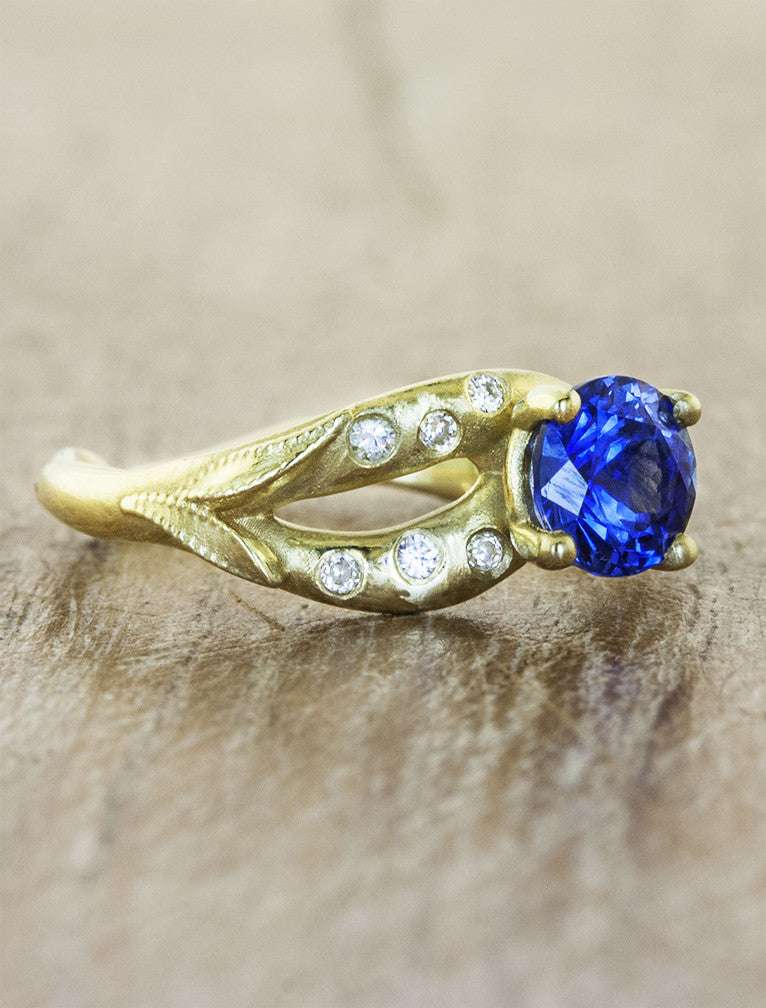 sapphire engagement ring, gold asymmetric band with diamonds