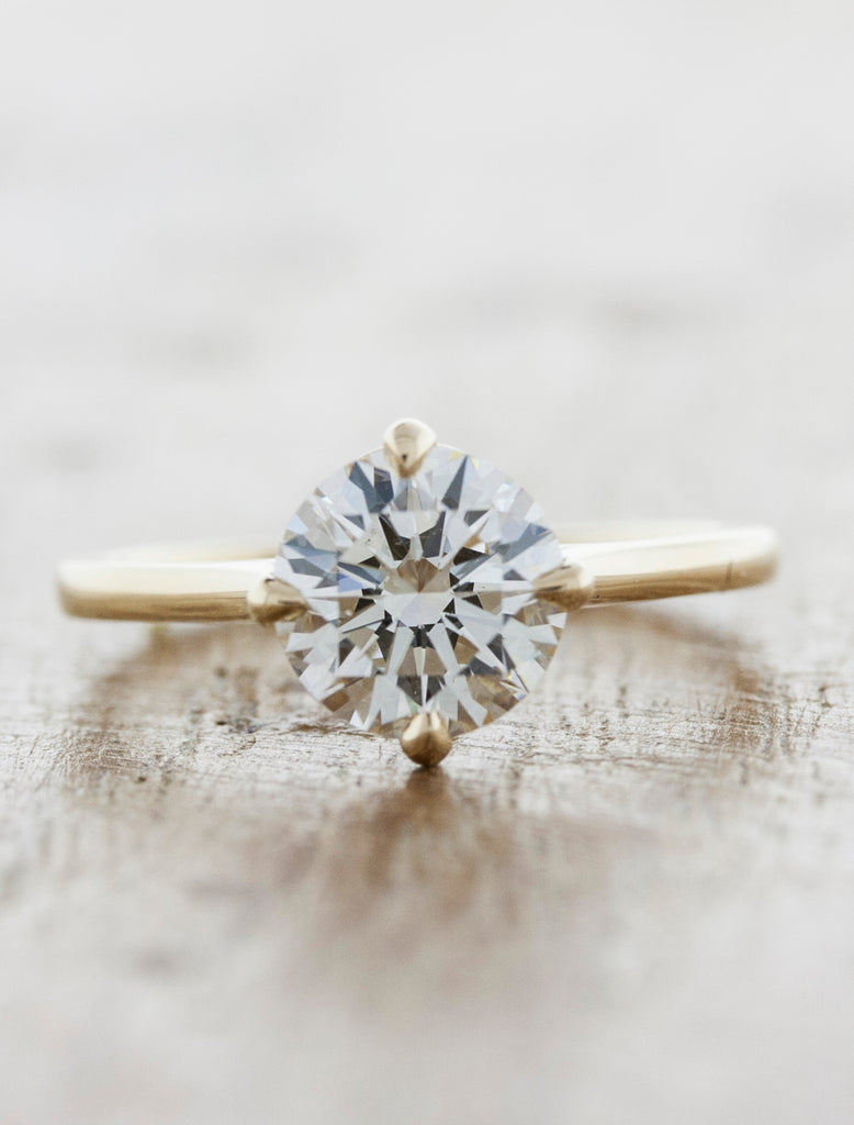 modern diamond solitaire engagement ring. caption:Shown with 1ct diamond option, 14k yellow gold