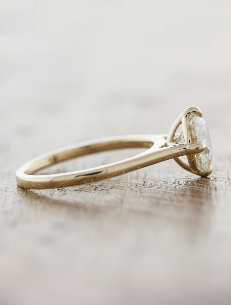 minimalist diamond solitaire engagement ring