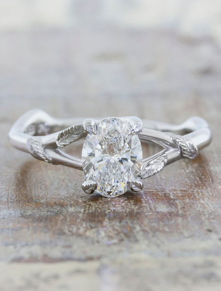 Nature inspired engagement ring;caption:1.00ct. Oval Diamond Platinum