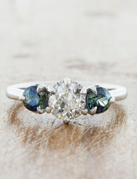 Ohara three stone caption:0.74ct. Old European Cut Diamond and Sapphires in Platinum