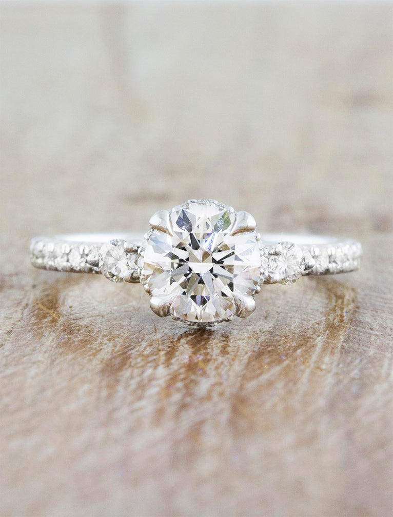 Multi-Stone Vintage Inspired Engagement Ring. caption:Pictured in 14k white gold, set with 0.88ct round diamond center stone