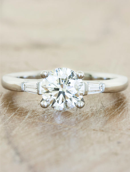 Three stone tapered baguettes;caption:1.00ct. Round Diamond 14k White Gold