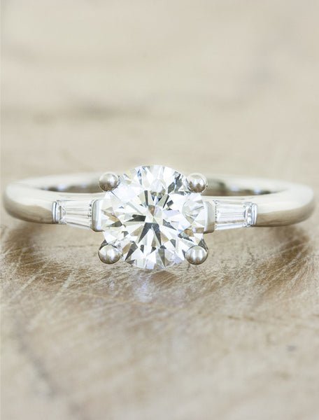 three stone diamond ring, baguette accents;caption:1.00ct. Round Diamond Platinum