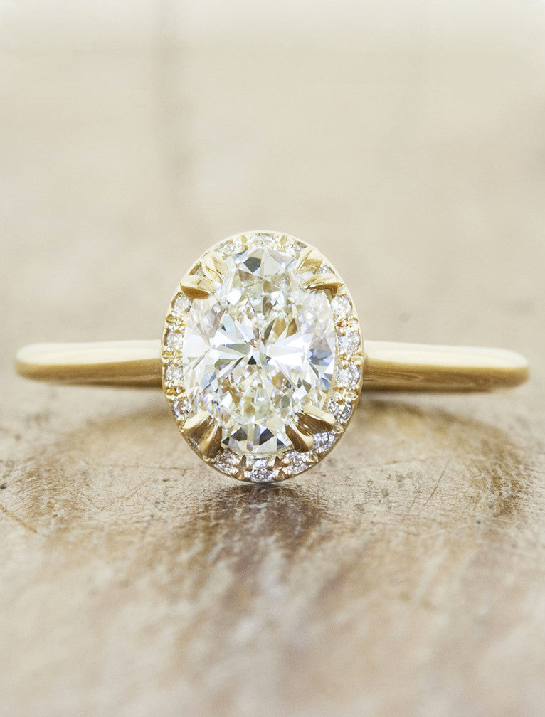 oval diamond engagement ring with subtle halo;caption:1.20ct. Oval Diamond 14k Yellow Gold