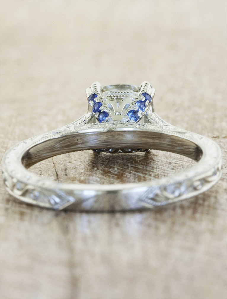 vintage inspired cushion cut diamond solitaire ring - subtle sapphire accents in setting