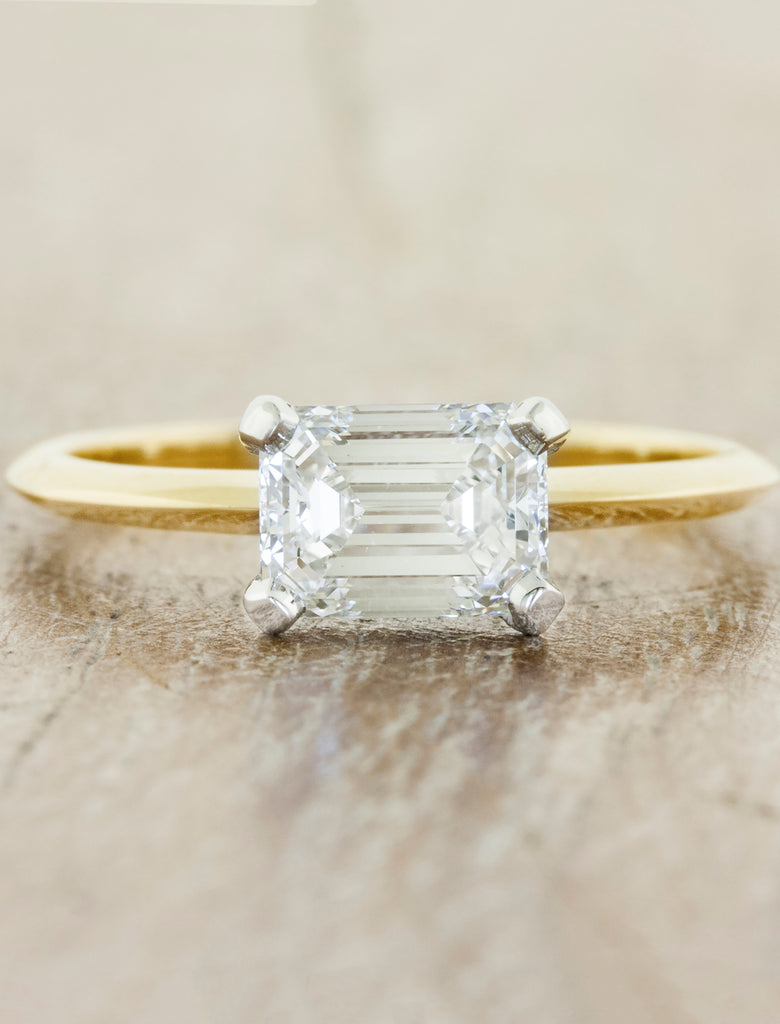 Mixed metal solitaire caption:1.00ct. Emerald Cut Diamond 14k Yellow Gold and Platinum