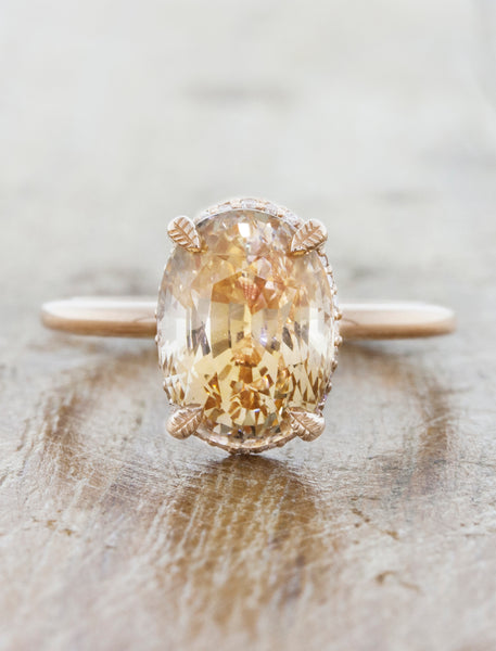 caption:Shown with a peach sapphire