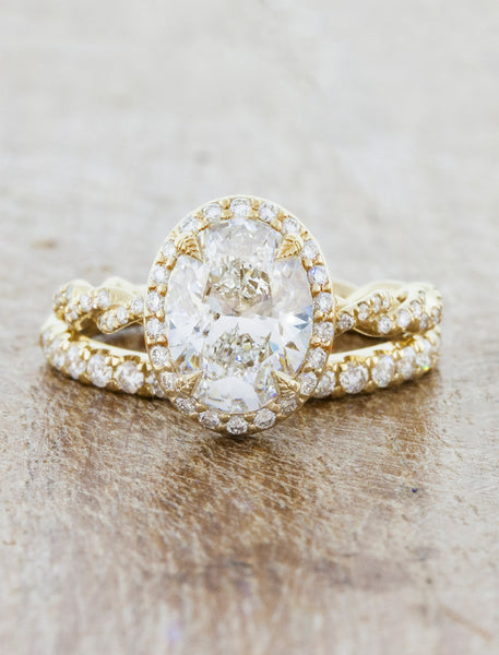 oval vintage inspired diamond ring, twisted band;caption:1.75ct. Oval Diamond 14k Yellow Gold paired with Bella Flat wedding band