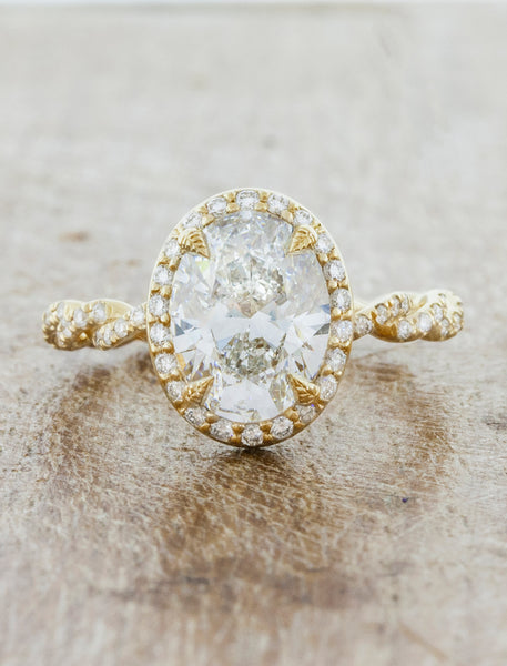 oval vintage inspired diamond ring, twisted band;caption:1.75ct. Oval Diamond 14k Yellow Gold