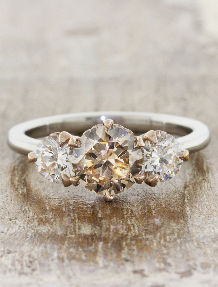 Ohara three stone caption:1.01ct. Round Cognac Diamond Platinum and 14k Rose Gold