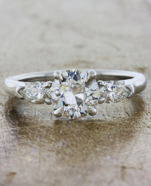 Oval diamond three stone engagement ring, pear side diamonds;caption:1.00ct. Round Diamond 14k White Gold