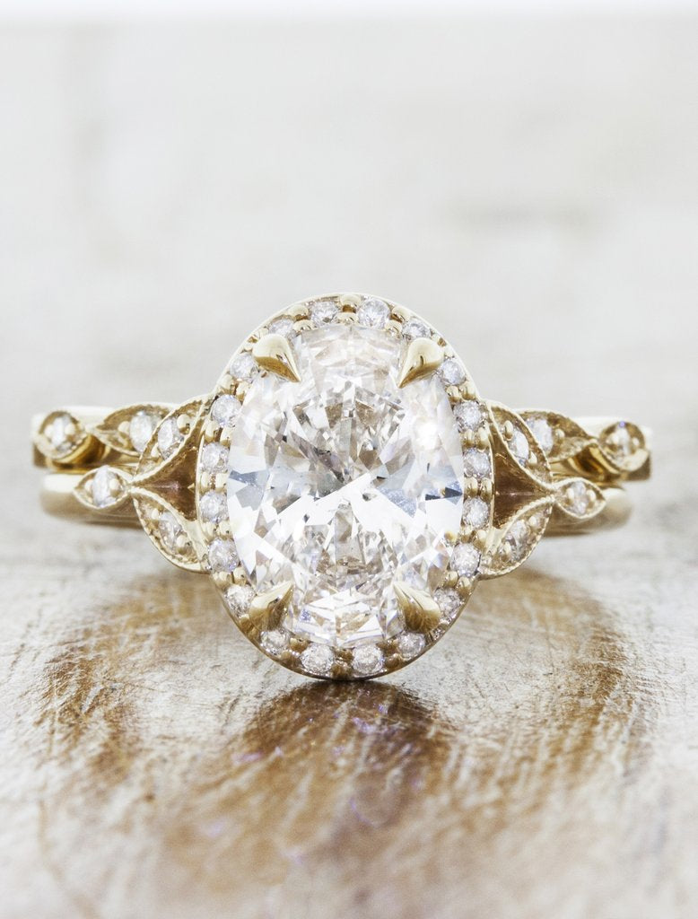 Vintage inspired engagement ring;caption:2.00ct. Oval Diamond 14k Yellow Gold paired with Lusia wedding band