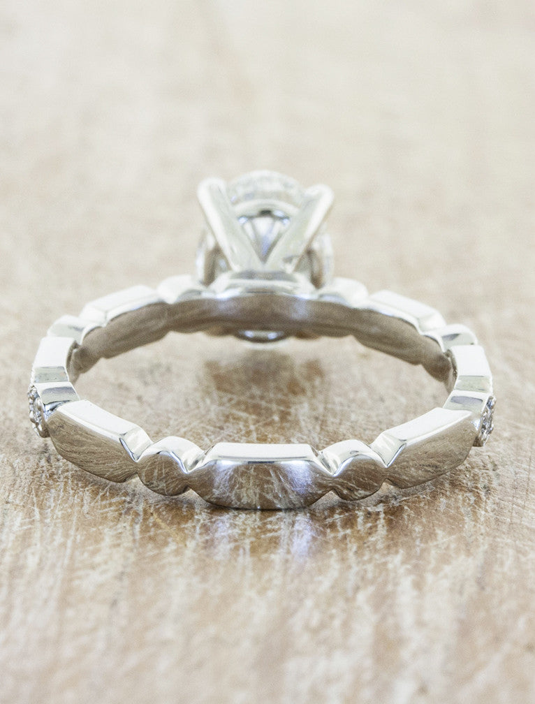 antique inspired oval diamond ring