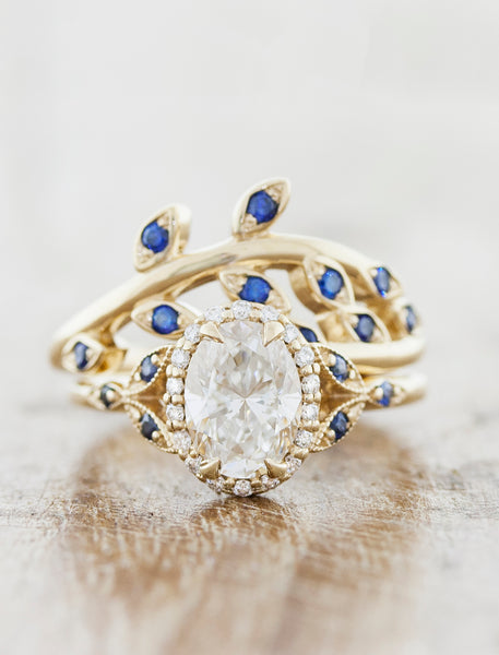 Vintage inspired halo engagement ring;caption:1.20ct. Oval Diamond 14k Yellow Gold paired with Sasha wedding band