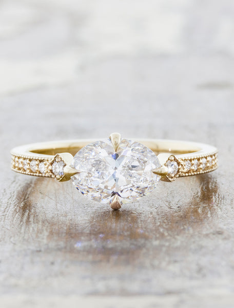 Vintage inspired engagement ring;caption:1.20ct. Oval Diamond 14k Yellow Gold